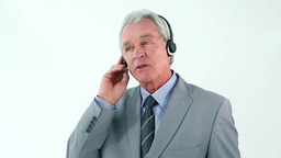 Smiling mature man using a headset Footage