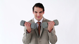 Smiling businessman holding weights Stock Video Footage