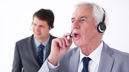 Serious businessmen using headsets Footage