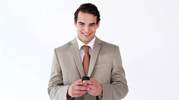 Smiling man sending a text with his cellphone Footage