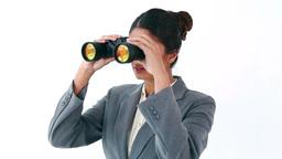 Happy businesswoman looking through binoculars Stock Video Footage
