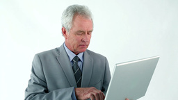 Serious businessman holding a laptop Stock Video Footage