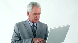 Serious businessman holding a laptop Footage