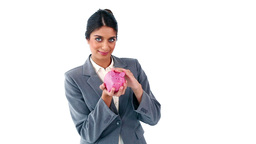 Smiling secretary holding a piggy bank Stock Video Footage