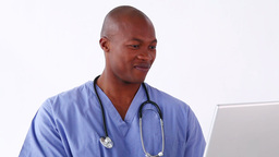 Happy doctor holding a laptop Stock Video Footage