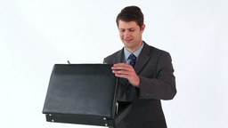 Happy man opening his briefcase Footage