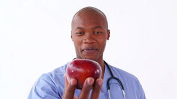 Happy nurse holding a red apple Footage