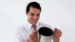 Smiling businessman holding a cup Stock Video Footage