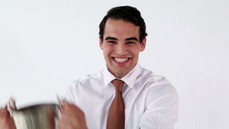 Smiling businessman holding a cup Footage