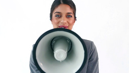 Brunette executive shouting in a megaphone Stock Video Footage