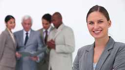 Businesswoman smiling in the foreground Stock Video Footage