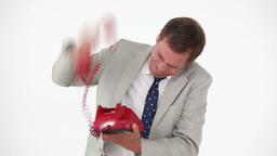 Angry man shouting in a red phone Stock Video Footage
