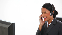 Businesswoman at her desk using a headset Stock Video Footage