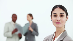 Woman in suit posing while colleagues are talking Footage