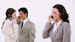 Three business people using cellphones Footage