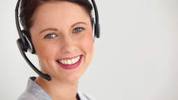 Woman welldressed wearing headset Footage