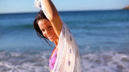 Smiling brunette holding her sarong Footage