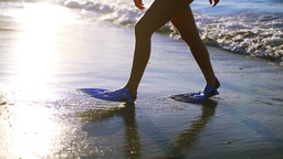Woman walking with swimming fins Footage
