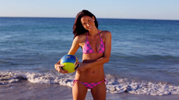 Smiling woman playing volleyball Footage