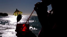 Woman drinking a cocktail Stock Video Footage