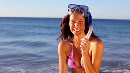 Smiling brunette wearing a snorkel Footage