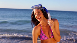 Smiling brunette wearing a snorkel Stock Video Footage