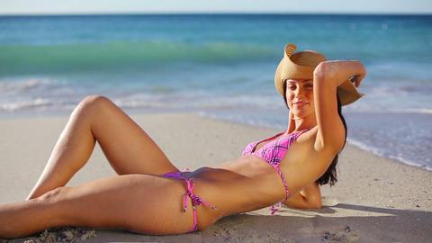 Brunette woman wearing a straw hat Stock Video Footage