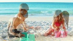 Siblings building sand castles Stock Video Footage