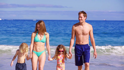 Happy family walking while holding their hands Footage