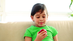 Smiling child eating an apple Stock Video Footage