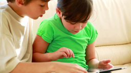 Children touching a tablet computer Footage