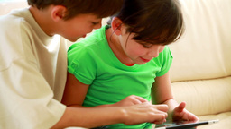 Children touching a tablet computer Stock Video Footage