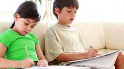 Girl looking at the exercises of her brother Live Action