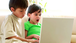 Children using a laptop together Footage