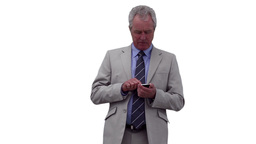 Businessman typing on his phone while looking away Stock Video Footage