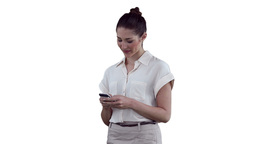 Businesswoman smiling as she reads a text message Stock Video Footage
