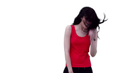 Woman bending as she waves her hair Stock Video Footage