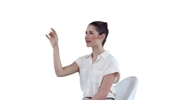 Businesswoman sitting while using a virtual touchs Footage