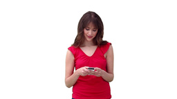 Woman reading a text message before looking to her Stock Video Footage