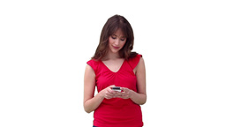 Woman reading a text message before looking to her Footage