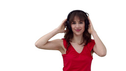 Woman dancing as she listens to music through head Footage