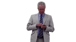 Businessman pressing buttons on his phone before l Footage