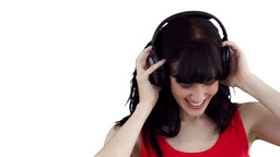 Close up of a woman swaying as she listens to musi Footage