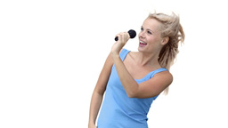 Blonde woman dancing as she sings into a microphon Footage