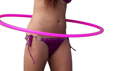 Close up of a woman spinning a hula hoop around he Footage