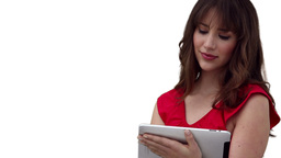 Woman using a tablet computer before looking at th Stock Video Footage