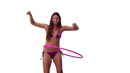Brunette woman spinning a hula hoop Stock Video Footage