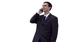 Businessman looking around while making a call Footage
