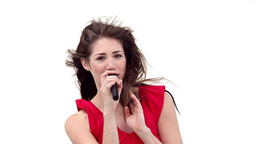 Woman singing as the wind blows through her hair Footage