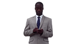 Businessman writing a text message before looking Stock Video Footage